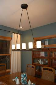 enthralling chandelier as dining room light fixtures design with white shade also black pipes