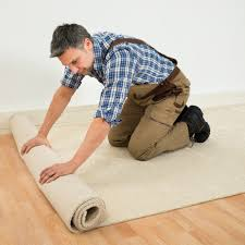 cleaning company york pa leppo carpet cleaners worker unrolling carpet on floor cleaning company in york pa