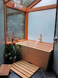 Bathroom : Small Bathroom With Rectangle Brown Modern Japanese Soaking Tub  Feat Soft Brown Bamboo Faucet Also Brown Wood Footpath And Clear Glass  Window ...