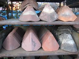 a bonnet or hip tile is a decorative roof tile that runs down the roof on a hip end they are installed to give a decorative finish and are normally