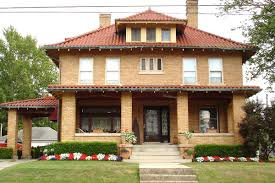 an american foursquare house made of brick with a terra cotta roof via creative commons