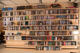 diy dvd shelves for large collection wall mounted shelves rh supernovaadventures com rotating dvd shelves big
