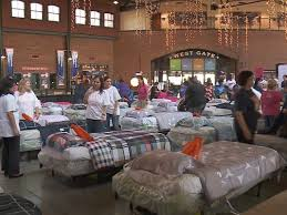 Louisville Bats Ashley Furniture team up to give beds to needy