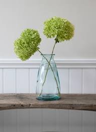 The simple shape of the Wells Flower Vase Large is crafted in 100% recycled  glass
