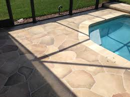 beautiful flagstone with travertine tile with flagstone coping around pool