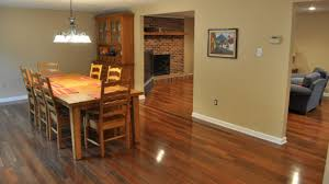 how to lay laminate flooring in multiple rooms newly installed hardwood flooring run in multiple rooms