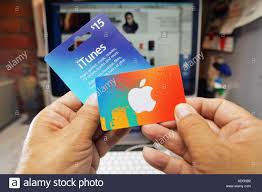 hands holding an itunes gift card stock image
