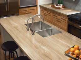 if you re considering travertine but want to look at a more budget friendly option try formica s solid surface countertops in travertine gold