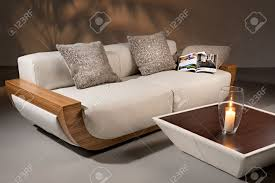 leather and wood sofa. Impressive Leather And Wood Sofa Images Design Whiteer With Brown Coffeetable Candle Journal Vase On Dark Grey Background Stock Photo Beautiful Concept T