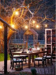 outdoor dining petaluma ca. outdoor eating area at night, globe lights and a potting cupboard. dining petaluma ca -