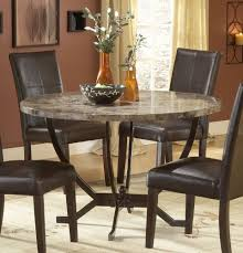 traditional black leather chairs and brown wall color idea also unusual round granite dining table design