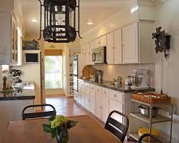 dark brown color wooden island decorate kitchen counter space white wooden cabinets brown quartz countertops glass