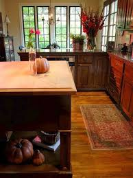 Traditional Brown Floor Kitchen Idea In Austin With Raised Panel Cabinets,  Dark Wood Cabinets