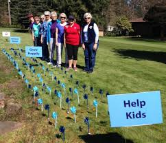 Women's club plants pinwheels for awareness of child abuse - The Columbian