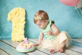 First Birthday Baby Girl In Mint And Yellow Dress With Her Birthday
