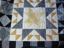 Connect the Dots With Free-Motion Quilting: Inspiration & Tips & Grey, White and Gold Quilt with Triangular Design Adamdwight.com