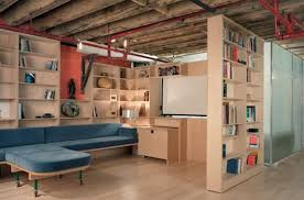 diy basement remodeling with wooden bookshelves