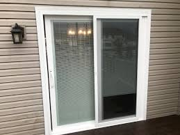 sliding patio door with blinds gives