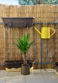 Balcony Fence yellow metal watering can pot hang on balcony railing bamboo 6778 by xevi.us