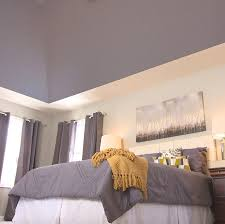 a ceiling painted a dark color makes the room cozier