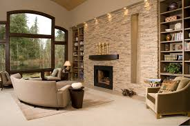 contemporary living room with stacked stone accent wall recess lighting and a fireplace with a