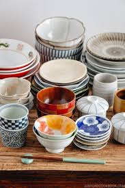 selection of japanese tableware including plates and bowls on a table