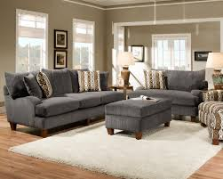 2 piece sectional sofa stone chaise on the left dark finish hardwood bun foot black laminated wooden table gray rug home improvement and interior