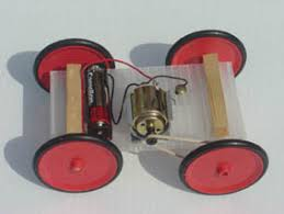 electric car model the car chassis is mad of a plastic board reinforced by wood blocks and eye screws that will also support the axles of the wheels