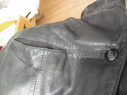 this leather jacket is made up of smaller leather pieces seamed together one of the things that impressed me was how they incorporated the