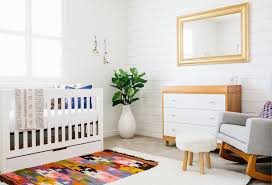 Scandinavian Modern Baby Nursery Design With Ethnic Patterned Area Rug