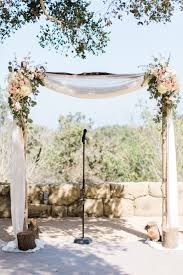 flower accented wedding arch