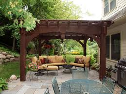 Outdoor Living:Modern Patio Design Using Dark Old Wooden Pergola Combined  With Cream Leather Outdoor