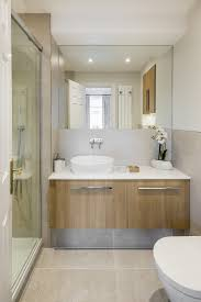 spa style ensuite with wavy tileodern basin units