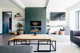 contemporary industrial lounge with dark grey feature wall and greenery