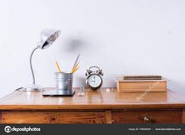 accessories alarm clock lamp on wooden office desk order table white wall toned minimalism style time management concept photo by olgapink