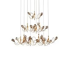 eurofase volare series 25681 017 low voltage chandelier gold 28 75 wide x 35 tall up to 72 overall height gold champage crystal ten 20wt g4 bi pin 12v