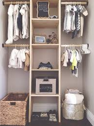 this neat nursery storage idea shows a closet separated in to 4 halves with a shelf