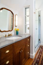 los angeles limestone countertops with nickel cup pulls bathroom farmhouse and salvaged wood widespread faucet