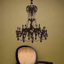 matte black large grunge chandelier on a golden teal wall