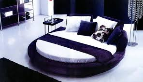 Contemporary Bedroom With Round Bed Featured White Mattress And Side Table