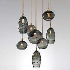 this multi port chandelier combines three optic n glass styles under one canopy shown