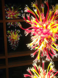 this two tiered red and yellow blown glass chandelier is by dale chihuly a world renowned glass artist from seattle i learned that the sculpture is a