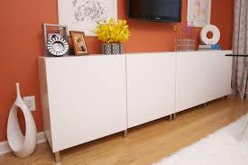 contemporary office credenza. This White Modern Credenza Is A Simple Design Accented By The Unique Pieces Of Art Mounted Contemporary Office R