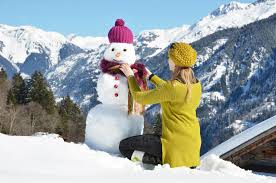 Download Girl decorating a snowman stock photo. Image of cold - 41693664