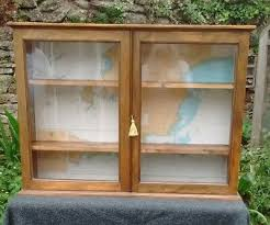 vintage wall cupboard with glass doors