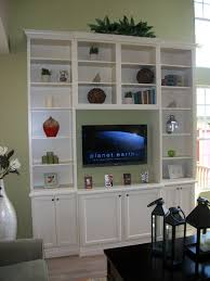 Tall Living Room Cabinets Diy Tall Entertainment Center With Stock Cabinets And Bookshelves