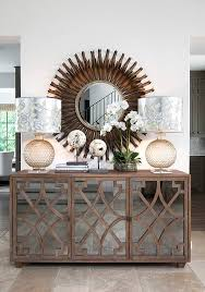 entryway furniture with mirror. the chic technique simply gorgeous entryway or foyer a mirrored buffet with decorative curved wood trim is dressed glass orbs lamps and shades furniture mirror y