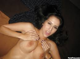 Latina babe Eve Evans stripping naked for some voyeur shots.
