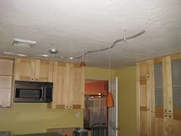 stainless kitchen wall mounted track lights featuring hanging stainless kitchen vent hoods