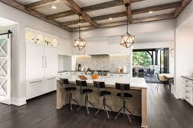 rustic kitchen with rustic pendant lights and wood beamed ceiling